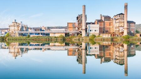 going places: Old paper factory that is reflected in the river