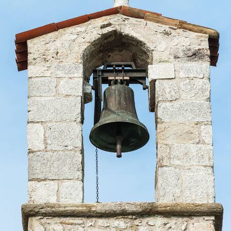 country church: Small bell tower with a bell of a country church in the 13th century