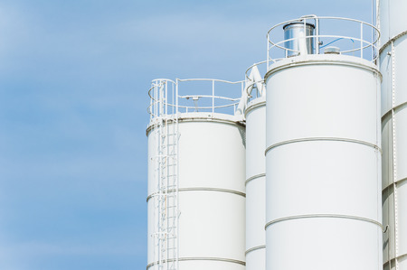 heavy industry: White silos for the production of concrete Stock Photo