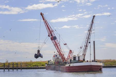 dredger: Dredger ship navy working to clean a navigation channel