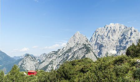 julian: Mountain landscape of the Julian Alps with Alpine shelter in Friuli, Italy