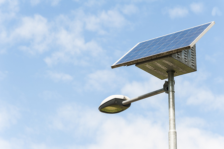 solar power plant: Street Light powered by a solar panel with a battery included Stock Photo