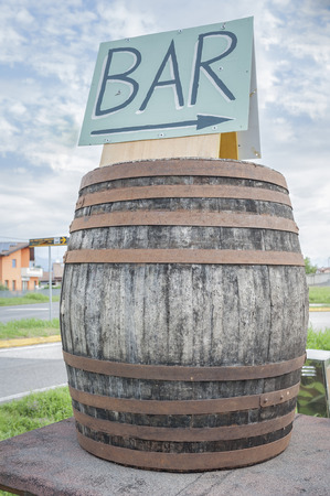 indicate: An old wine barrel to indicate a bar Stock Photo