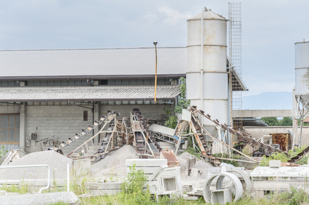 precast: Small factory for products of precast concrete for wells and discharges Stock Photo