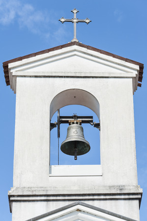 country church: Small bell tower with a bell of a country church i Stock Photo