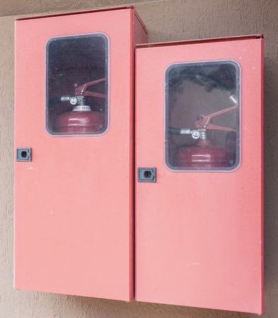 fire extinguishers: Two fire extinguishers in their lockers red.