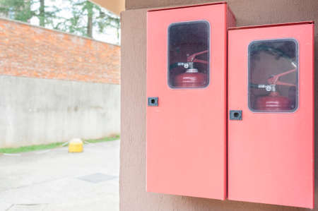 fire extinguishers: Two fire extinguishers in their lockers red. Copy space Stock Photo