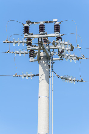 amperage: Power isolator switch manual on electrical pylon against the blue sky