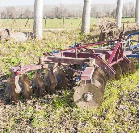 harrow: Tool for agriculture: disc harrow used to cultivate the soil.