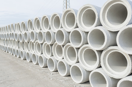 Concrete drainage pipes for industrial building construction. Stok Fotoğraf - 50330252
