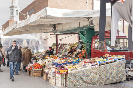 weekly market: Codroipo,Udine,Italy  - 19 January 2015 :   Stall of fruit and vegetables for sale at an outdoor weekly market in the North East of Italy