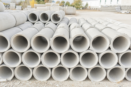 culvert: Concrete drainage pipes for industrial building construction.