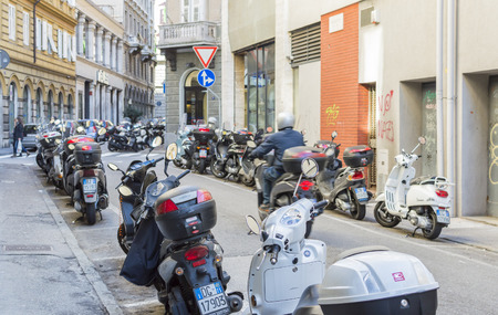 areas: Trieste, Italy - February 5, 2016: motorcycles parked in designated areas.