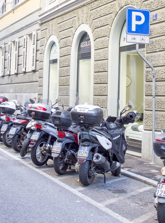 designated: Trieste, Italy - February 5, 2016: motorcycles parked in designated areas.