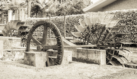prospector: Old iron wheel a watermill. Ruins of a watermill. Effect vintage.