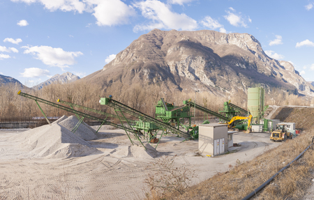 extraction: Gravel extraction plant.   Machinery and classification according gravel size distribution via conveyor belts.
