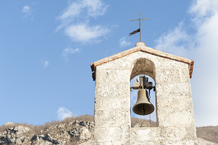 country church: Small bell tower with a bell of a country church in the 15th century
