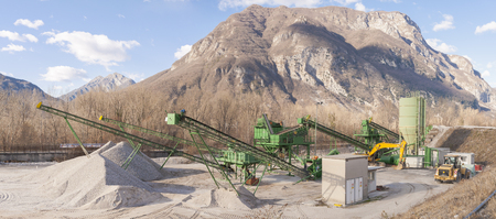 aggregates: Gravel extraction plant.   Machinery and classification according gravel size distribution via conveyor belts.
