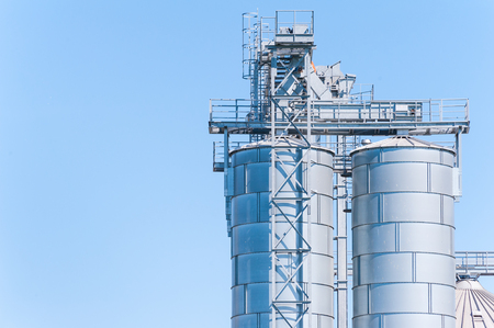 Storage facility cereals and production of biogas; silos and drying towers Stock Photo