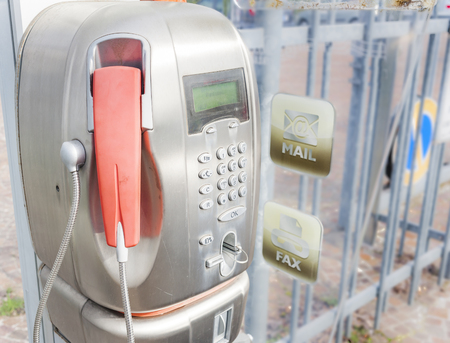 payphone: Old public payphone, no longer in operation. Stock Photo