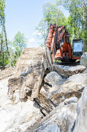 earthmover: Excavator with big shovel to work with rocks