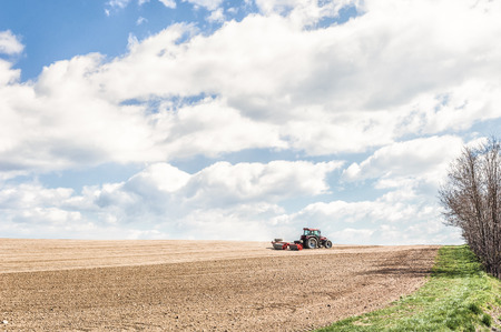 rollers: Farm work. Tractor compresses the soil after planting with rollers.