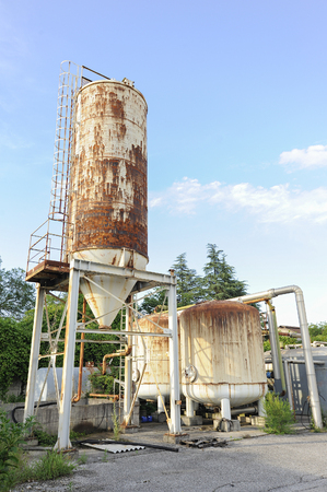 country store: Old industrial chemical silos. Tank for small chemical plant.