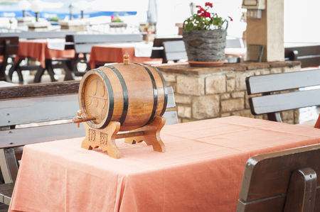 hogshead: Small barrel of wine on table of restaurant