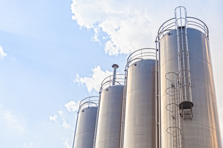 silos: Industrial silos for chemical production, by stainless steel. Stock Photo