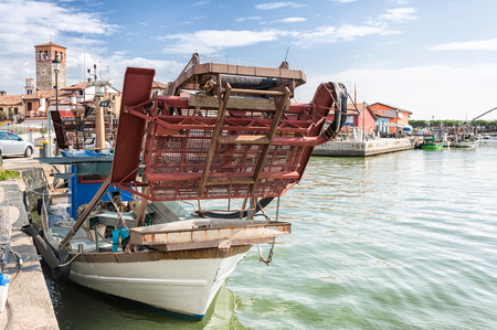 Draga snow blower for fishing bivalve molluscs mounted on a fishing boat Stock Photo