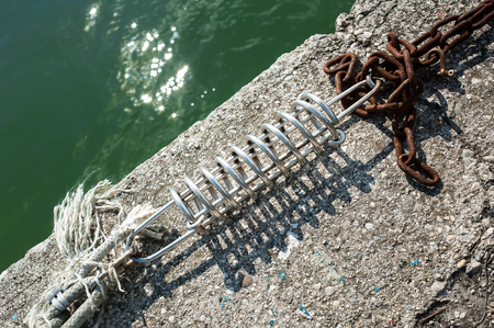 Mooring spring detail with marine ropes and chain