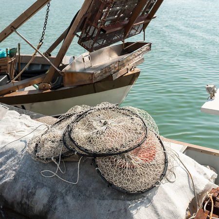 net trade: Pot made of nylon net with more rooms suitable for fishing in the lagoon to dry on the pier.