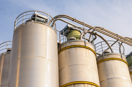 silos: Detail of chemical plant, silos and pipes