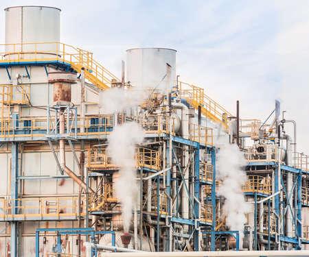 smokestacks: Chemical plant of a factory. Smokestacks ,pipes and tank.