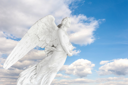 angel cemetery: Photo montage with 150 year old Angel cemetery statue on blue sky with clouds