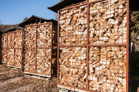 Chipped fire wood in packing on pallets Stock Photo