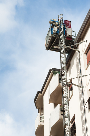 hoists: Hoists for buildings attached to the wall. For the workers and materials. Stock Photo