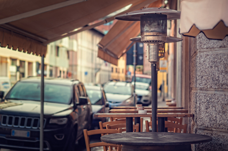 Gas heater, patio heater, mushroom heater, umbrella heater. Tables for eating outdoors.