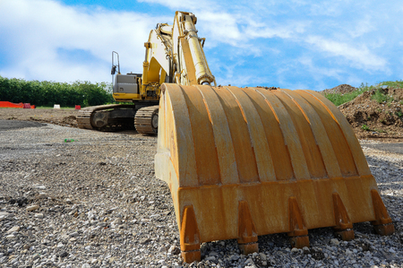 Close up of an excavator on blue sky. Stock Photo