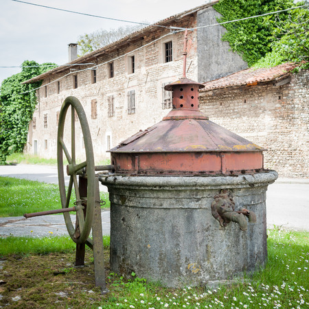 Old well covered with hand pump. It needed around the country. Stock Photo