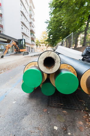 Road works in the city. Installation of steel tubes with thermal insulation. Steam heating.