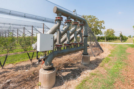 Hydraulic plant for submersible pumping system in an orchard.