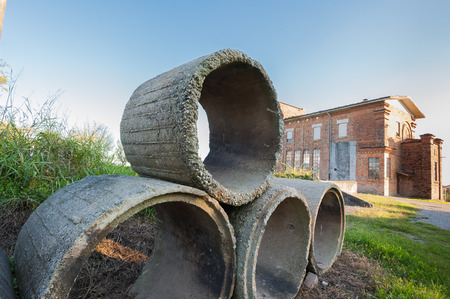 Old concrete tubes. Pipes for drainage. Hoses for construction industry. Фото со стока