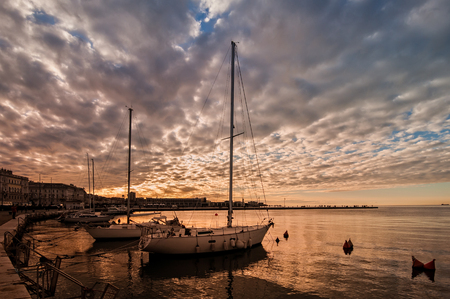 Pleasure boats moor  in harbor at sunset. Stock Photo
