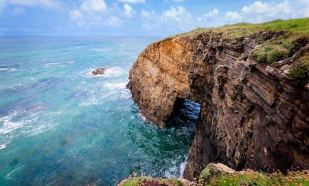 Landscape of sea, cliff blue sky with clouds. Ocean coast in the north west of Spain, Galicia region. Touristic travel.