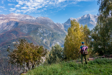 Man hiker watch the landscape of  mountain in autumn