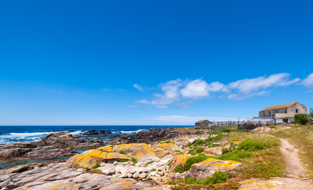 Landscape with sea,cliff, beach and blue sky. Galicia Spain. Vacation travel.