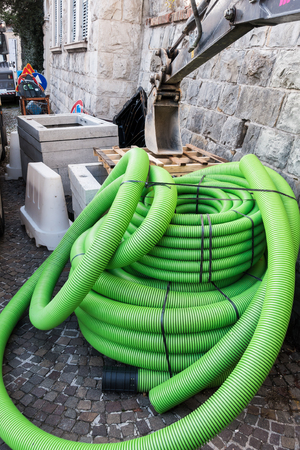 Roll of plastic pipe for road works. Protection of electric or telephone cables Zdjęcie Seryjne
