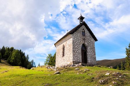The little church on mountain small village. Religion building Zdjęcie Seryjne