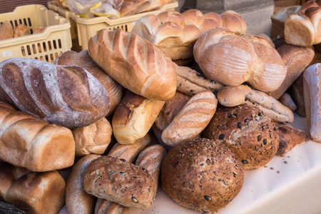 Assortment of bread in the shop.  Different fresh bread on market.